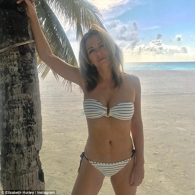 Bikini babe: The strapless bikini top featured a slight plunging neckline which teased at her bust while her enviable abs were on show as she slipped on a pair of matching bikini bottoms that boasted navy tie-side detailing